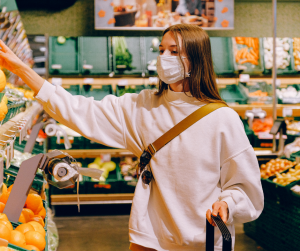 woman wearing face covering in supermarket
